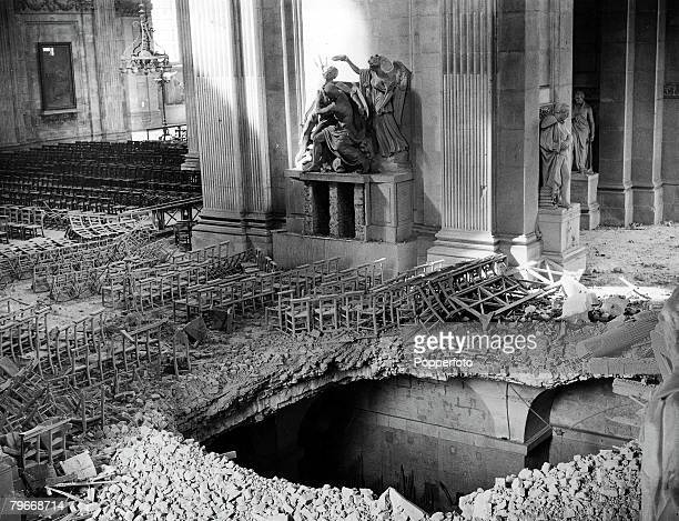 Volume 2 Page 127 Picture 2 World War Two London England 18th April A view showing a huge hole in the transept floor of St Pauls cathedral after it...