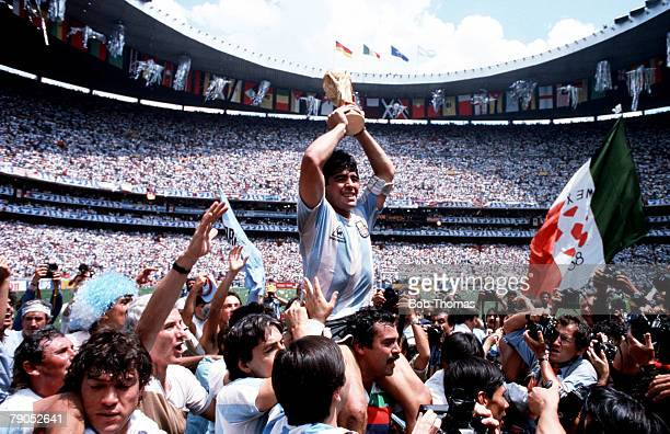 Volume 2 Page 13 Picture 4 Sport Football World Cup Final Argentina Captain Diego Maradona holds the World Cup trophy whilst being carried on his...