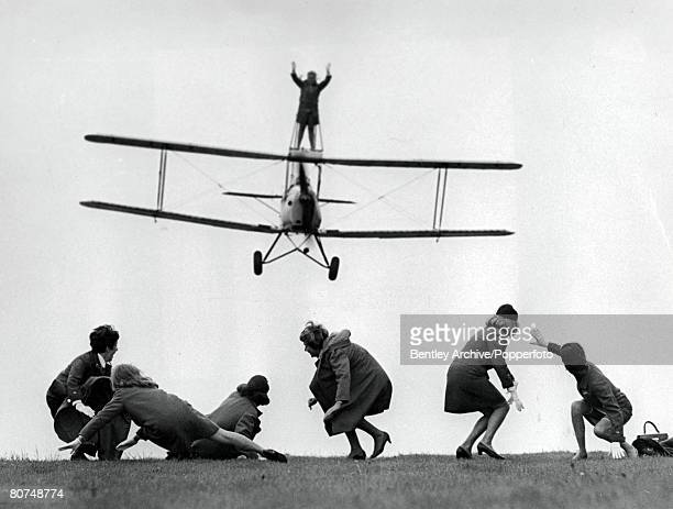 Volume 2 Page 130 Picture 5 Wycombe Air Park England 23rd May 28yearold BEA air stewardess Elaine Mitchael wingwalking on top of a Tiger Moth biplane...