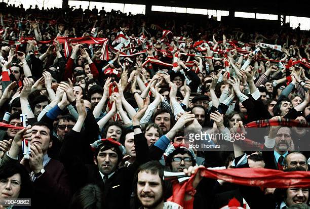 Football c1970 Liverpool fans on The Kop wave their arms in the crowd at Anfield