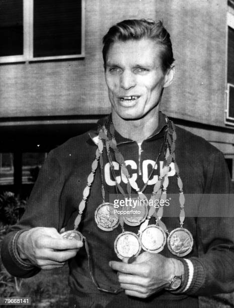 Volume 2 Page 22 Picture 1 11th September 1960 Olympics Italy Boris Shaklin Soviet Gymnast with six of the seven Olympic medals he won at the games...