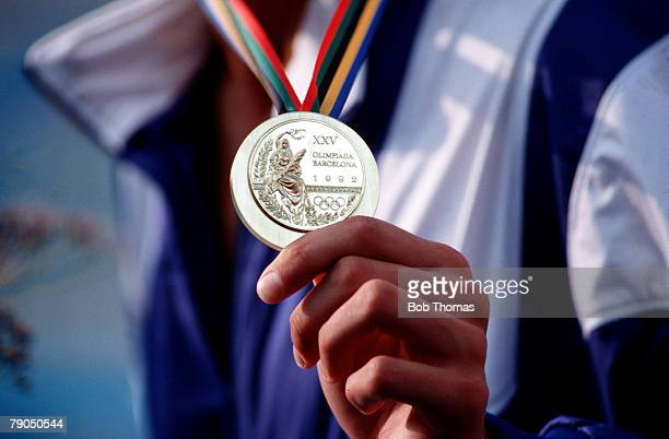 Volume 2 Page 27 Picture 7 Sport Olympics The Olympic gold medal displayed on a ribbon around an athlete's neck at the Barcelona Olympics 1992