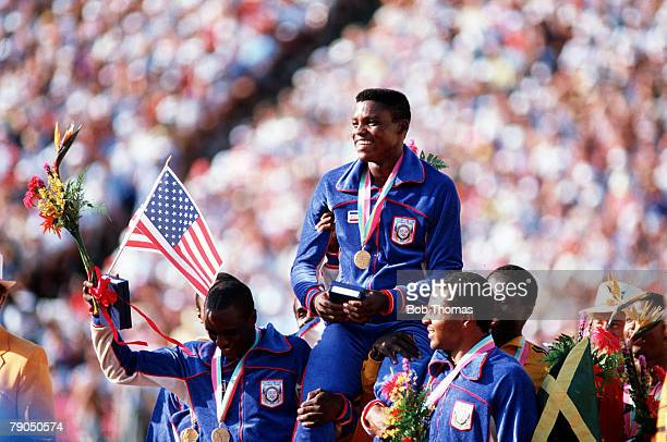Volume 2 Page 28 Picture 11 Sport Olympics Carl Lewis of the USA is hoisted on the shoulders of jubilant teammates after winning his fourth gold...