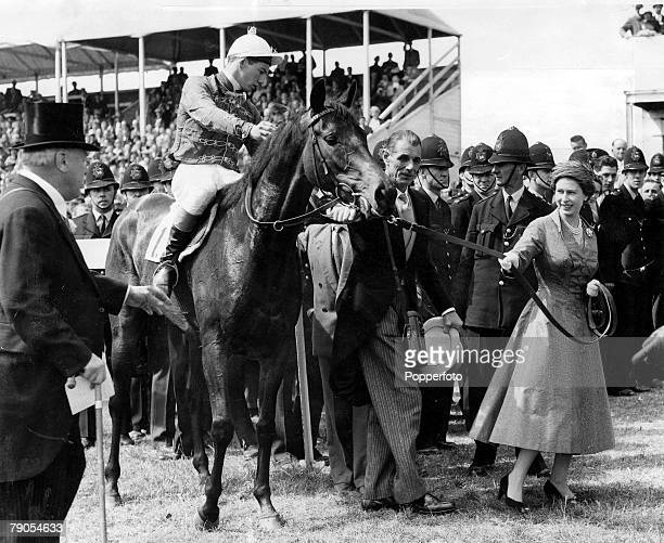 34 Picture 7 Horse Racing The Oaks Epsom Surrey England 7th June Her Majesty Queen Elizabeth II leads her horse in after jockey Lester Piggott had...