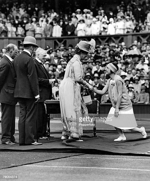 Volume 2, Page 36,Pic 4, Tennis, Wimbledon, London Susan Lenglen is presented to King George V and Queen Mary after winning the Women+s World...