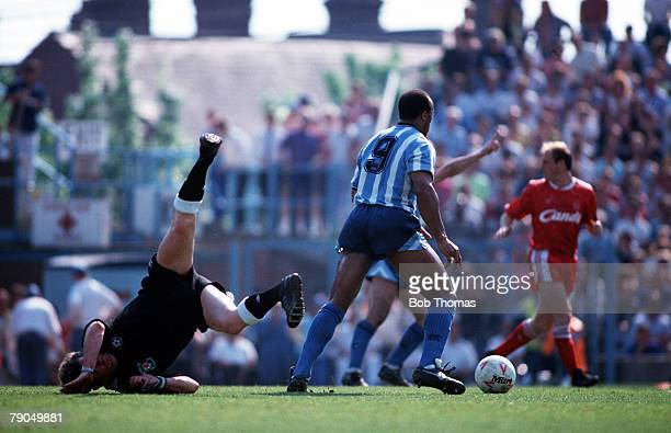 Volume 2 Page 4 Picture 2 Sport Football League division 1 Coventry v Liverpool 5th May 1990 Referee FFRANGCON ROBERTS falls as Coventry City's...