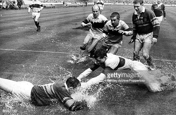 Volume 2 Page 4 Picture 8 Sport Rugby League 12th May 1968 Rugby League Cup Final Leeds v Wakefield Trinity A Leeds forward is tackled by a Wakefield...