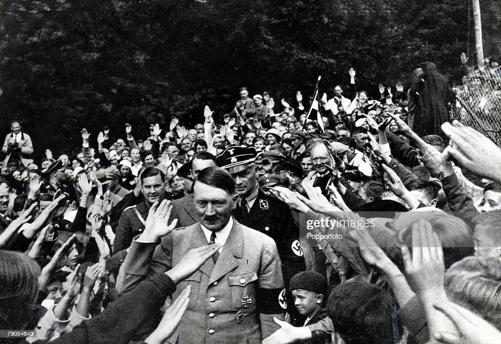 Volume 2. Page 40. Picture 1. Nazi leader Adolf Hitler waves to the crowd as he is given the Nazi salute by thousands of supporters. : News Photo
