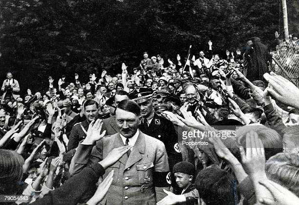 Volume 2 Page 40 Picture 1 Nazi leader Adolf Hitler waves to the crowd as he is given the Nazi salute by thousands of supporters