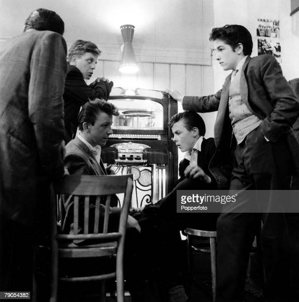 Volume 2 Page 46Pic 8 London England 13th July 1955 A group of Teddy Boys congregate around a jukebox