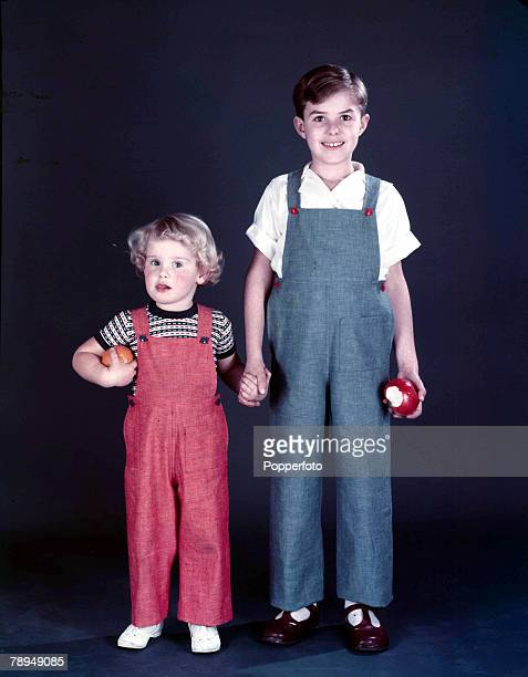 51 Picture 2 Studio portrait of two young boys wearing blue and red bibbed overalls 1958