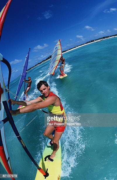 Volume 2 Page 6 Picture number 1 Sport Windsurfing Three windsurfers ride the waves Fisheye view with blue sea and sky