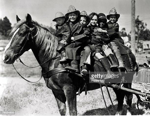 Volume 2 Page 63 Picture 7 Six children from Our Gang dressed up as Firemen sit together on one horse USA Los Angeles c1925