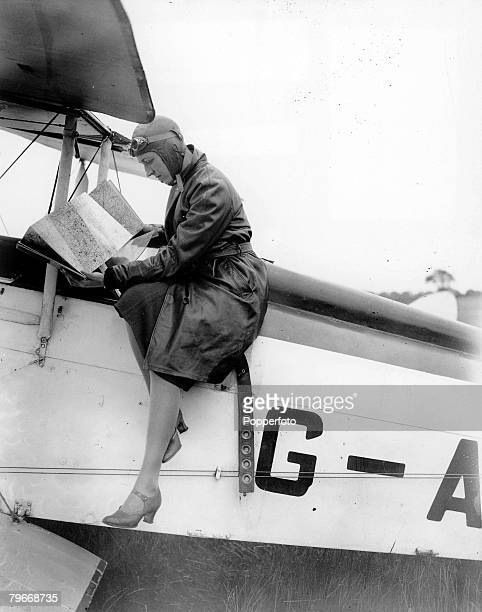 Volume 2 Page 68 Picture 2 Aviation 30th May 1931 London England British Aviatrix Amy Johnson studies a map before taking off from Heston en route to...