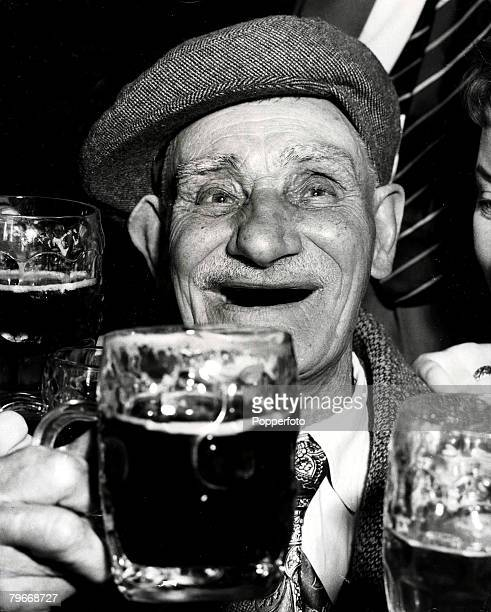 Volume 2 Page 78 Picture 10 A centenarian celebrates his birthday with a pint of beer 7th November 1958