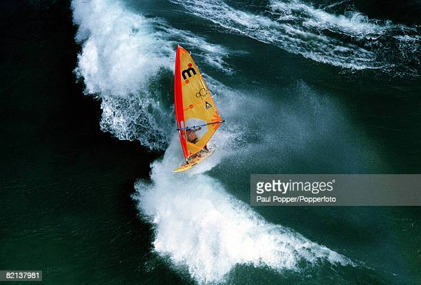 Volume 2 Page 9 Picture number 2 Sport A panoramic view of a windsurfer riding on the crest of a wave