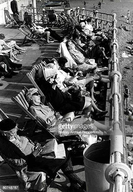 Volume 2, Page 94, Picture 5, 10th October Brighton, England, Line of older men and women, sleeping in deckchairs, by the beach