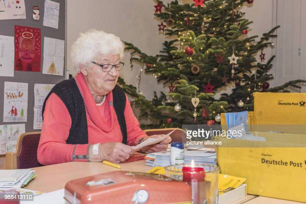 Voluntary helper Annita Lorenz reads one of many letters to Santa Claus at the Christ Child Post Office in Himmelpforten Germany 29 November 2017 The...