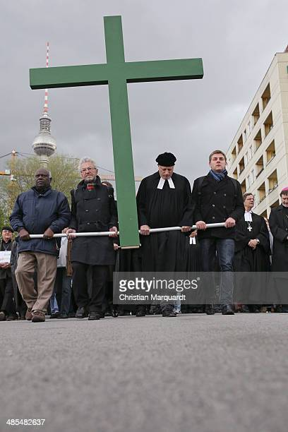Voluntary helpers carry a wooden cross during the ecumenical Good Friday procession on April 18 2014 in Berlin Germany Under the theme of...