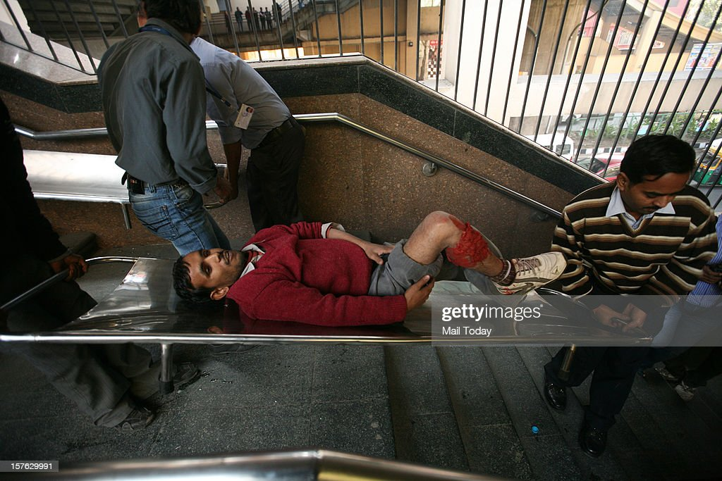 Volunteer acting as bomb blast victims wait for rescue operation during a mock security drill as part of Delhi Emergency Management Exercise (DEMEX) in New Delhi on Tuesday.