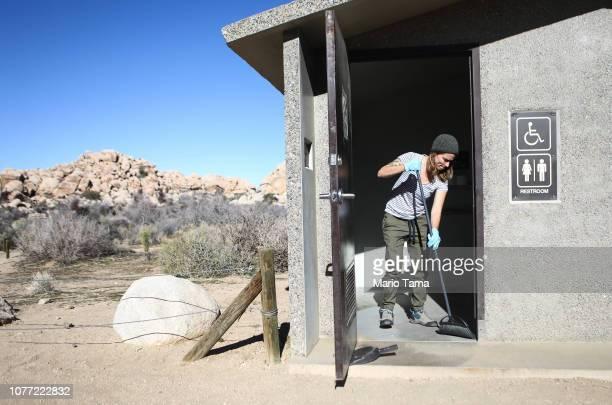 Volunteer Alexandra Degen cleans a restroom at Joshua Tree National Park on January 4 2019 in Joshua Tree National Park California Volunteers with...