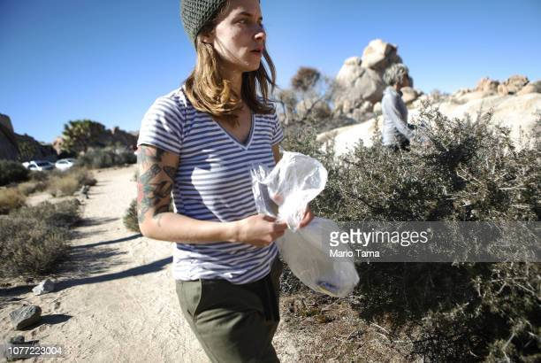 Volunteer Alexandra Degen searches for 'microtrash' to clean at Joshua Tree National Park on January 4, 2019 in Joshua Tree National Park,...