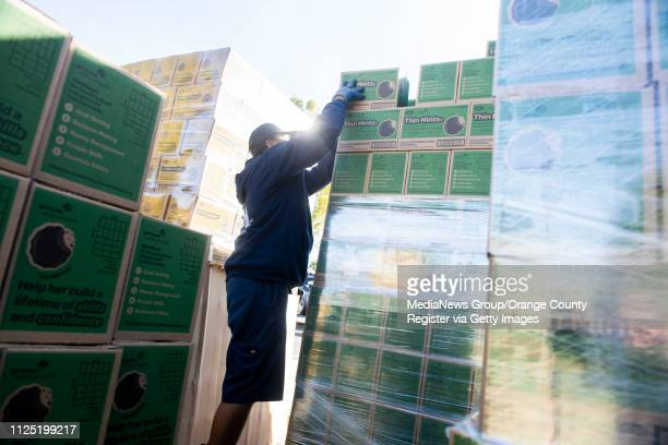 Volunteer Alfredo Vargas of Garden Grove helps keep the supply of Thin Mints moving during the Girl Scout Cookie Mega Drop at the Anaheim Business...