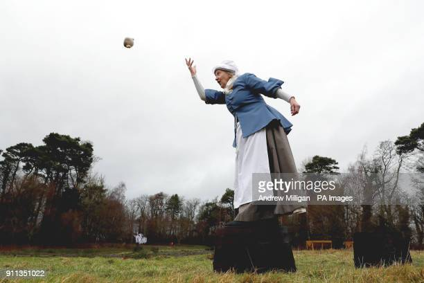 Volunteer Alison Wilson dresses as Agnes Burns to demonstrate how to hurl a haggis at Burns Cottage in Alloway at the World Haggis Hurling...
