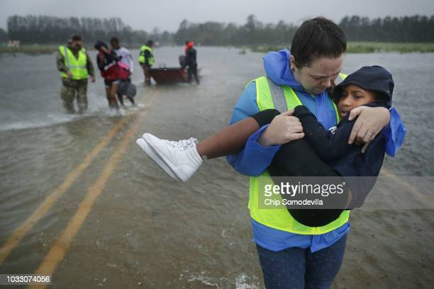 Volunteer Amber Hersel from the Civilian Crisis Response Team helps rescue 7yearold Keiyana Cromartie and her family from their flooded home...