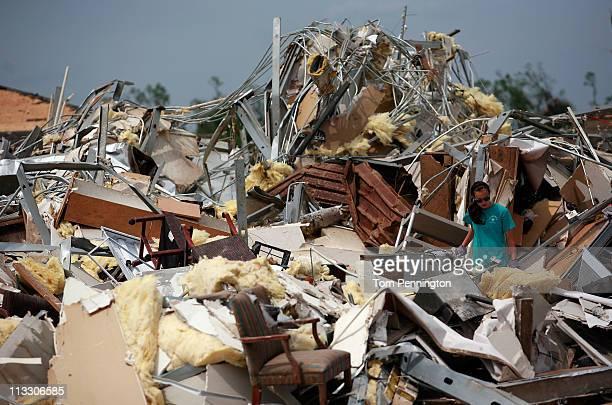 Volunteer Anna Porter combs through the rubble of Alberta Elementary School on May 1, 2011 in Tuscaloosa, Alabama. Alabama, the hardest-hit of six...