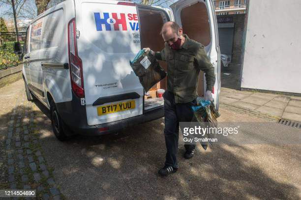A volunteer arrives with food donated to the project at the Queen's Crescent Community Association on March 24 2020 in Kentish Town North London...