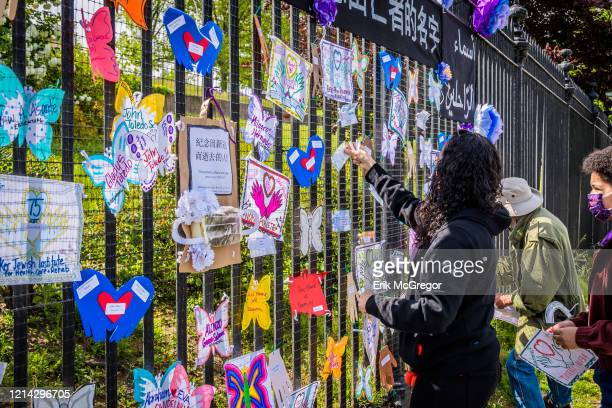 Volunteer artist setting up a memorial in Brooklyn. Artists and volunteer organizers across New York City put up physical memorials throughout the...