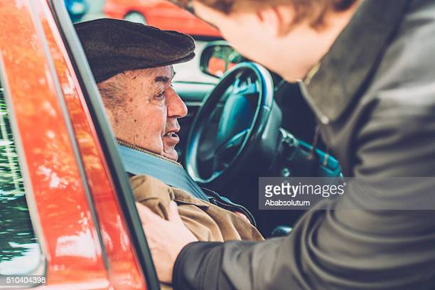 Volunteer, Assistant, Grandson Helping Senior Man into the Car, Europe