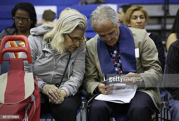 A volunteer assists an immigrant with her US citizenship application at a Citizenship Now event held by City University of New York on May 14 2016 in...
