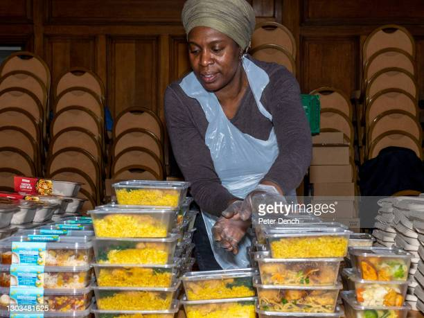 Volunteer at The Community Food Hub at Tottenham Town Hall on February 19 ,2021 in London, England. Tottenham has a multicultural population . As a...
