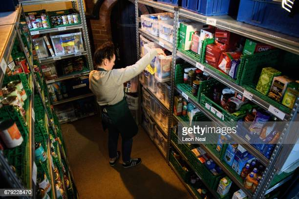 A volunteer at Wandsworth foodbank prepares food parcels for guests from their stores of donated food toiletries and other items on May 5 2017 in...
