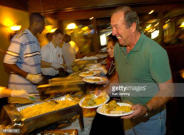 Volunteer Bob Hunter loaded up plates Thursday afternoon at Ciancio's restuarant 9650 Sheridan at the Hyland Hills Golf Course The restaurant served...