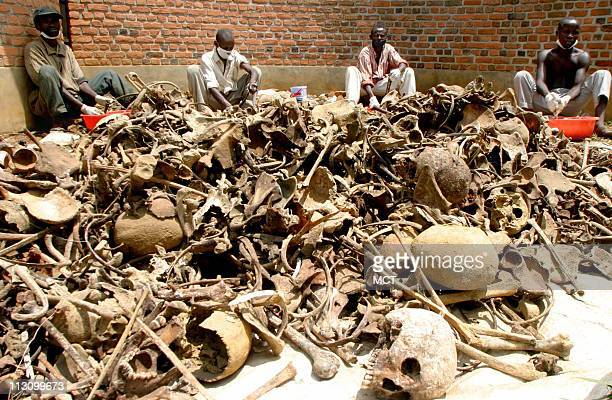 Volunteer bone cleaners wash skulls from a mass grave at the Nyamata church Rwanda after the grave was discovered three weeks ago April 2 2004 The...