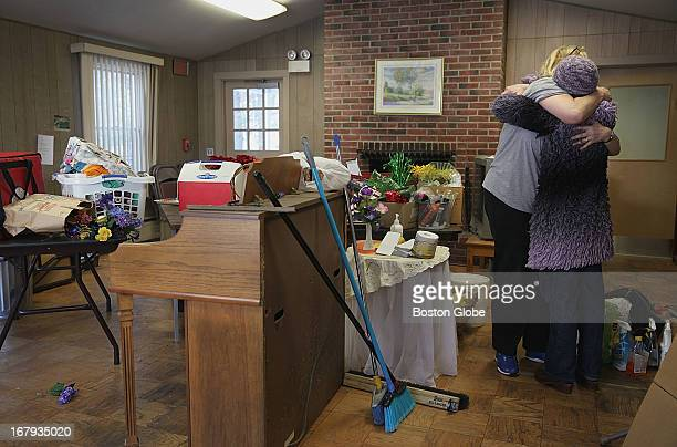 Volunteer Caroline Cheshire embraced Mary Clunan who helped to disassemble chairs at the Newport Park recreation room in ManchesterByTheSea where...