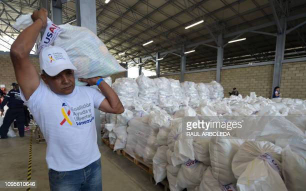 A volunteer carries a bag with US humanitarian aid goods in Cucuta Colombia on the border with Tachira Venezuela on February 8 2019 Venezuelan...