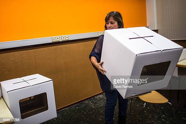 A volunteer carries a ballot box at a school on November 8 2014 in Barcelona Spain The unofficial Catalan Independence vote will be held this Sunday...