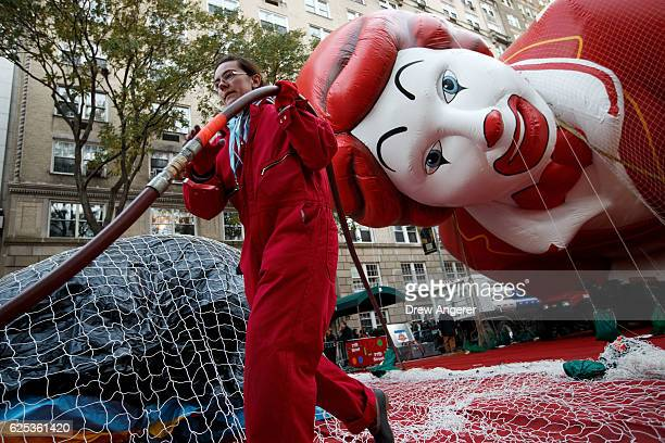 A volunteer carries a helium hose prior to Thursday's Macy's Thanksgiving Day Parade November 23 2016 in New York City This year will be the 90th...