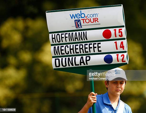 A volunteer carries a signboard during the final round of the Chiquita Classic held at The Club at Longview on September 30 2012 in Weddington North...
