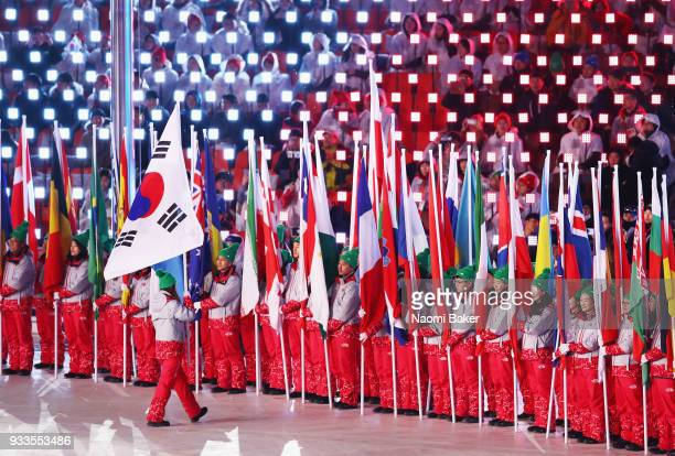 A volunteer carries the South Korea flag during the closing ceremony of the PyeongChang 2018 Paralympic Games at the PyeongChang Olympic Stadium on...