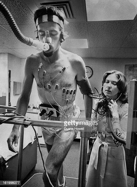 JUN 15 1977 JUN 16 1977 Volunteer Chris Chambers Gives Computer The Lowdown On His CardioPulmonary System Research assistant Arlene Neiccoli monitors...