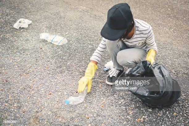 Volunteer Collecting Garbage On Road