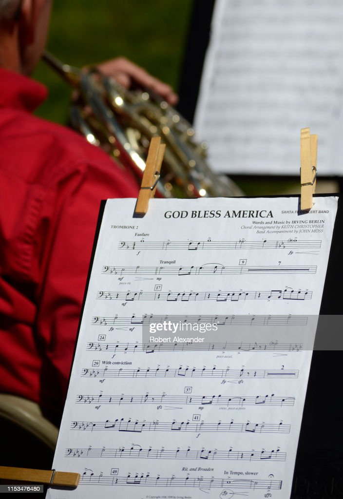 A volunteer concert band plays patriotic songs including