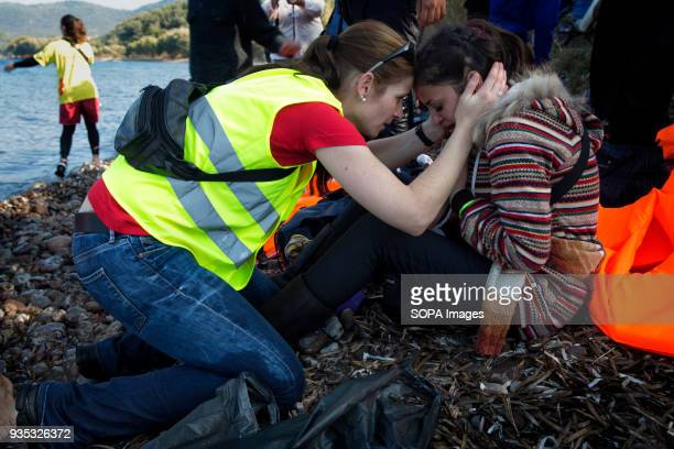 A volunteer consoling an asylumseeker who arrived by boat to Greece after crossing the Aegean Sea in a rubber boat In 2015 more than a million...