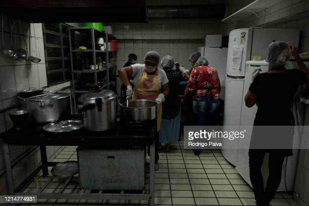 A volunteer cooks in the community kitchen to donate food to Paraisópolis residents on March 24 2020 in Sao Paulo Brazil Paraisopolis is the second...