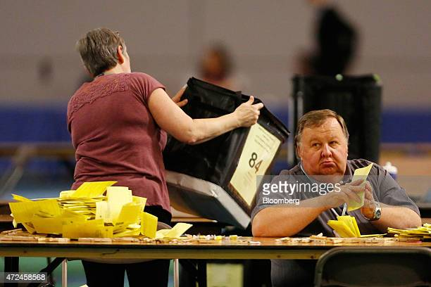 A volunteer counts ballot papers inside the English Institute of Sport including ballot papers for the constituency of Sheffield Hallam where Liberal...